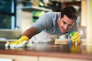 man-cleaning-the-kitchen